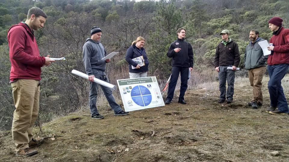 Lomakatsi with AFR project partners on the ground reviewing ecological restoration prescriptions developed for City of Ashland lands.