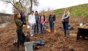 Lomakatsi's Riparian Restoration Manager Niki Del Pizzo training Cascade Christian High School students how to identify and plant native trees and shrubs.