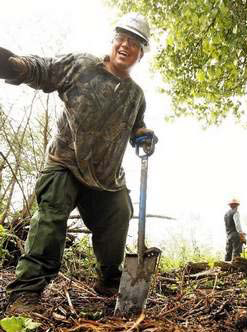 Justice Blacksun of Klamath Falls works on blackberry removal and tree maintenance along the confluence of Ashland and Bear Creeks.  Ashland Daily Tidings, Vickie Aldous, May 26, 2011