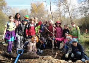 Students also helped plant large trees like this Oregon ash