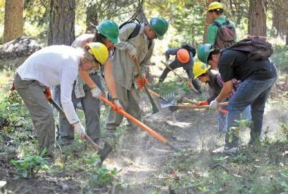 Workers build a fire line.  Photo by Jamie Lusch, Tidings, 7-23-13.