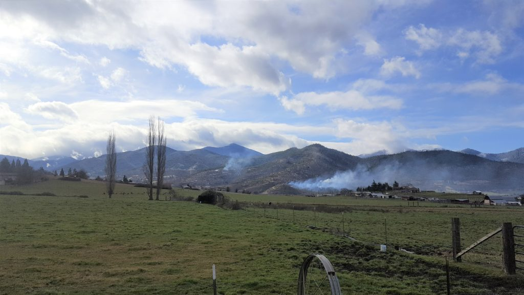 Smoke rises from controlled burns in the Ashland watershed. The AFAR partnership has treated more than eight thousand acres of forest land in and around the City of Ashland to reduce the risk of intense fire that would threaten forest and urban lands.